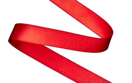 red ribbon bow: close up of  a red ribbon on white background