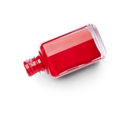 nailpolish: close up of  a nail polish bottle and drop on white background