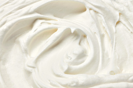 Sour cream: close up of  a white whipped or sour cream on white background