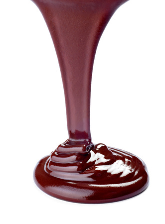 chocolate syrup: close up of chocolate syrup on white background