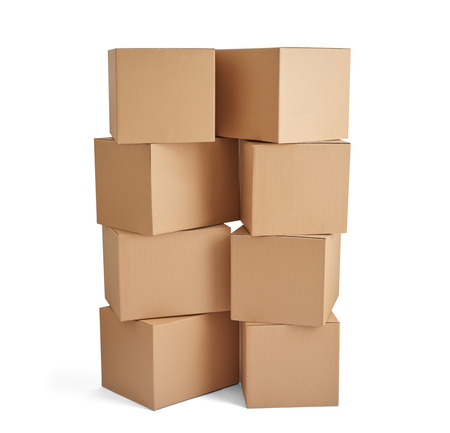 ship order: close up of  a stack of cardboard boxes on white background Stock Photo
