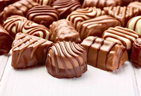 praline: close up of chocolate praline on wooden background Stock Photo