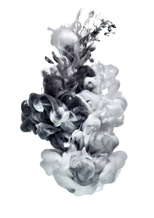 white and black paint in water 写真素材