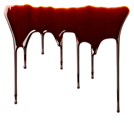 leaking: close up of chocolate syrup leaking on white background