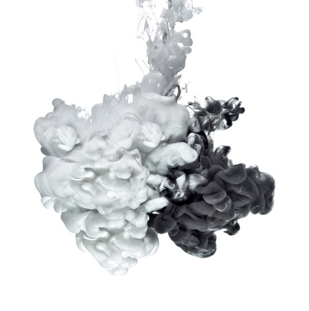 white and black paint in water Stock Photo