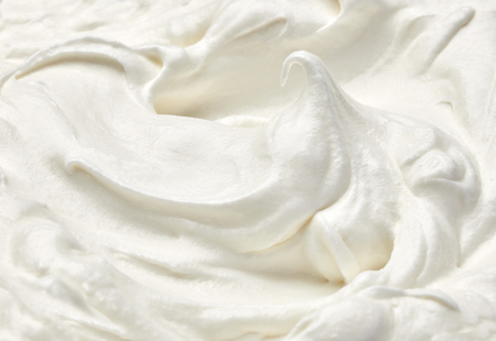 close up of  a white whipped or sour cream on white background