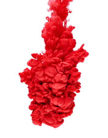 red color paint pouring in water