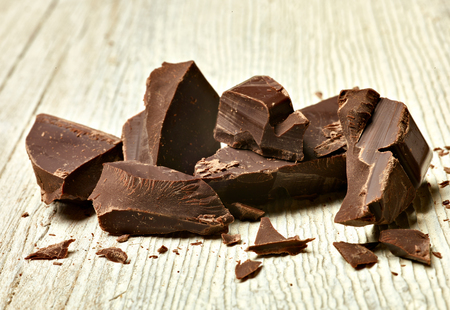 close up of chocolate pieces on  wooden background Stock Photo - 77667597