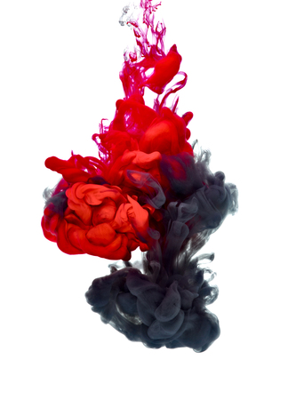 red and black paint in water Stock Photo
