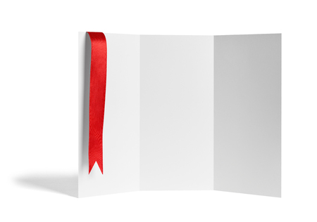 close up of a note card or leaflet brochure with ribbon bow on white background