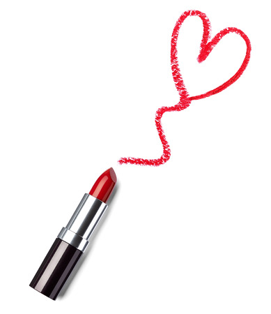 close up of  a lipstick and a heart shape on white background