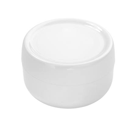 close up of a white beauty cream on white background