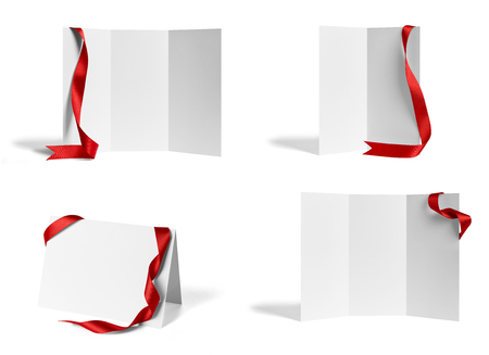collection of various  blank folded leaflet or a desktop calendar with ribbon on white background. Stock Photo