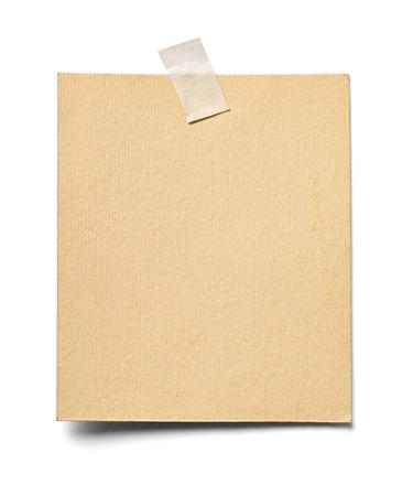 Cerca de una nota de papel sobre fondo blanco. Foto de archivo