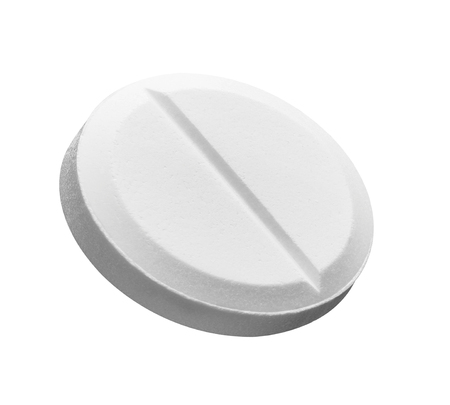 close up of a white pill on white background