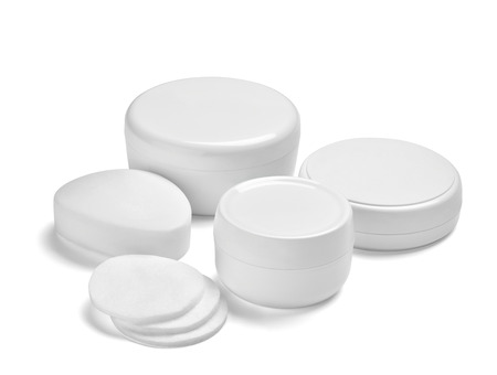 close up of  a white beauty cream container,tube and soap bar on white background