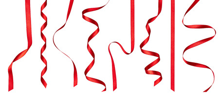 collection of various red ribbon pieces on white background. each one is shot separately Reklamní fotografie