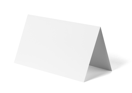 close up of a  blank folded leaflet or a desktop calendar white paper on white background Archivio Fotografico