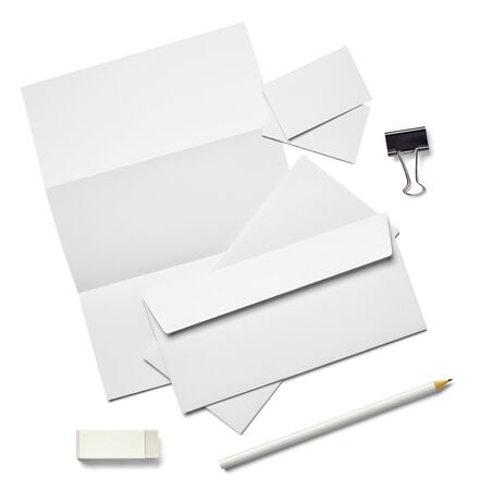 collection of various white business print, pencil,foldback clip templates on white background. each one is shot separately