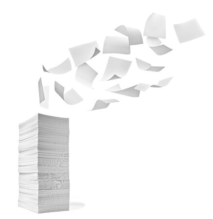 close up of a stack of paper and flying papers on white background