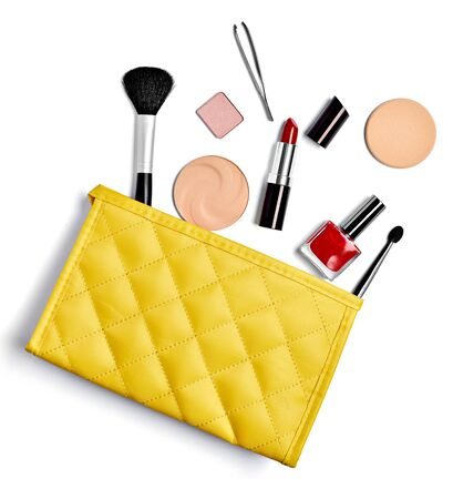 close up of  a vanity case full of make up on white background Фото со стока - 129879834