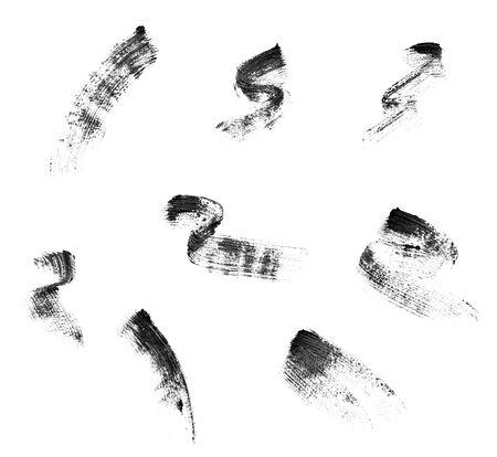 Cerca de una máscara de pestañas sobre fondo blanco. Foto de archivo