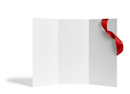 close up of a  blank folded leaflet or a desktop calendar with ribbon on white background