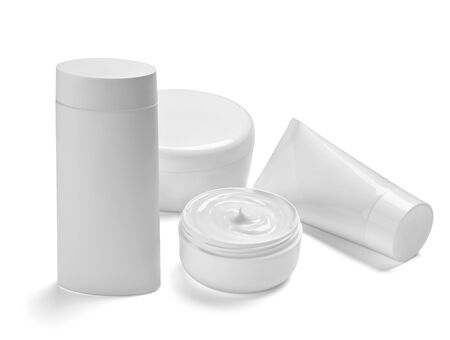 close up of  a white beauty cream container and tube on white background