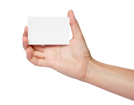 close up of  a female hand holding blank note card sign on white background