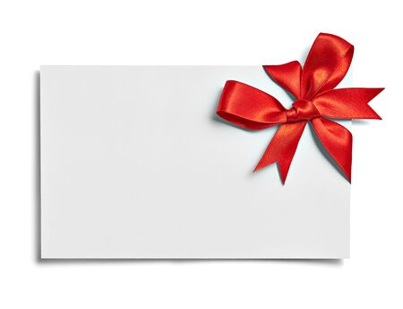 close up of a note card with red ribbon bow on white background Imagens