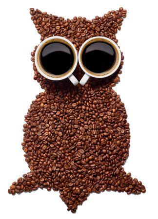 close up of a coffee cup with coffee beans and an owl shape on white background Banque d'images - 131930770