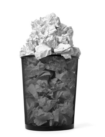 close up of paper balls inside trash bin on white background