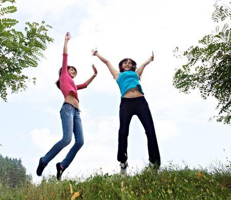 beautiful girls jumpin in the air Stock fotó - 138471433