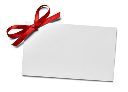 close up of a note card with ribbon bow on white background Foto de archivo - 138471280