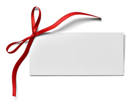 close up of a note card with ribbon bow on white background Foto de archivo - 138471351