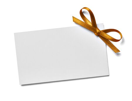 close up of a note card with ribbon bow on white background Foto de archivo - 138471270