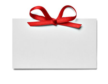 close up of a note card with ribbon bow on white background Foto de archivo - 138470986