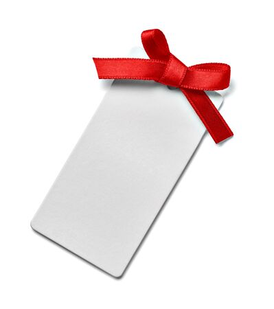 close up of a greeting card note with red ribbon on white background Foto de archivo - 138471002