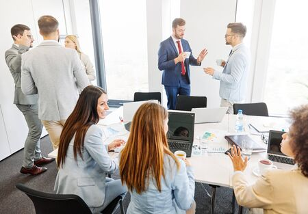 Group of young business people having a meeting in the office Stock Photo