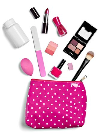 close up of  a vanity case full of make up on white background