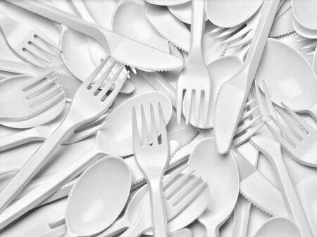 close up of plastic cutlery spoon, fork, knife on white background Archivio Fotografico