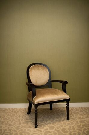 classic chair style in vintage room with green wall Standard-Bild