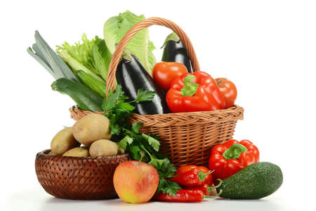 Composition with raw vegetables and wicker basket isolated on white background Stockfoto