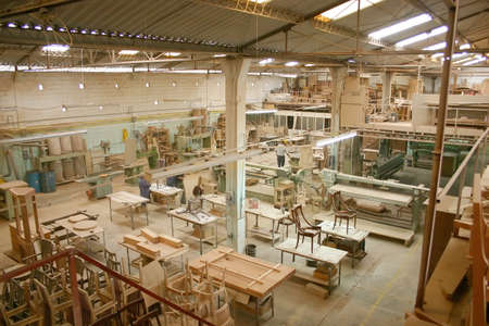 furniture manufacturing process in a warehouse 免版税图像