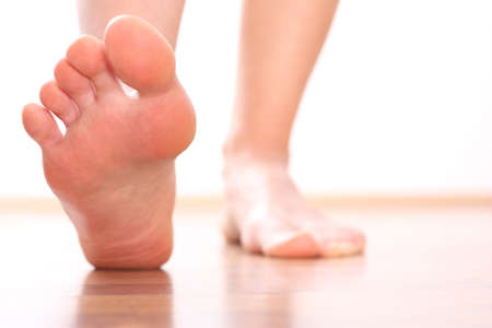 woman's foot, bare Foot stepping Imagens
