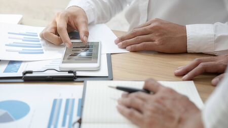 Business team brainstorming and discussing with financial data and report graph. Teamwork meeting working concept. Stock Photo