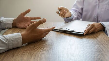 Psychiatrist or professional psychologist consulting on diagnostic examination disease or mental illness in medical clinic or hospital mental. Medical and Healthy service concept. Stock Photo