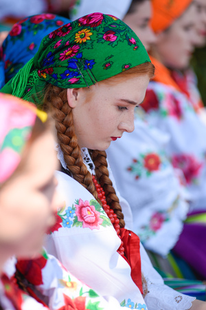 Lowicz / Poland - May 31.2018: Local, regional choir of young women and men dressed in folklore costumes. Colorful skirts and pants, white shirts, vivid head kerchief, black vests. Stock fotó - 115825439