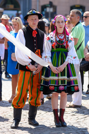 Lowicz / Poland - May 31.2018: View of a couple, man and woman dressed in a colorful folklore, regional costume during Corpus Christi Celebration.
