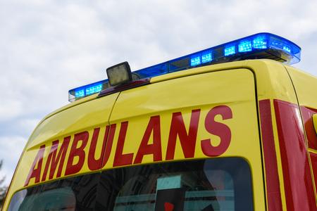 Yellow Ambulance Car with blue neon warning lights.